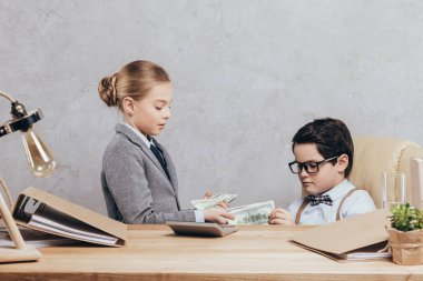 children with cash at workplace