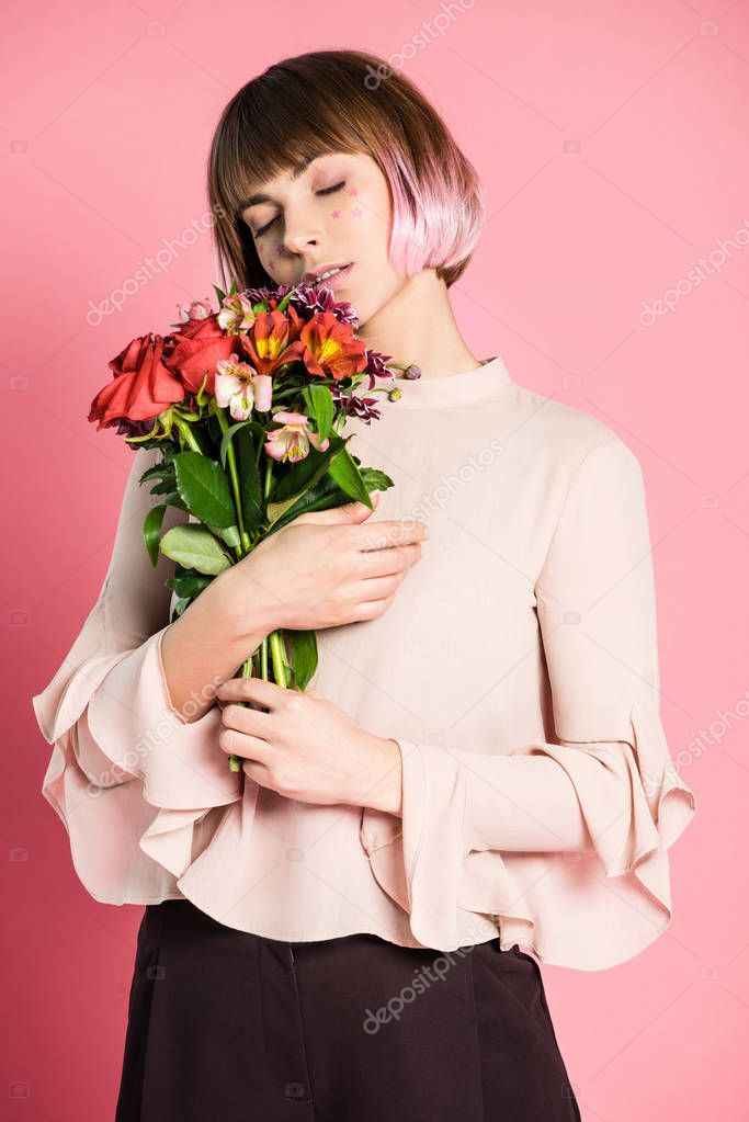 Fashionable woman holding bouquet