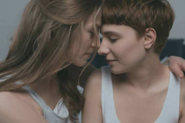close-up hot of young cuddling lesbian couple