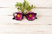Eyeglasses and pink flowers