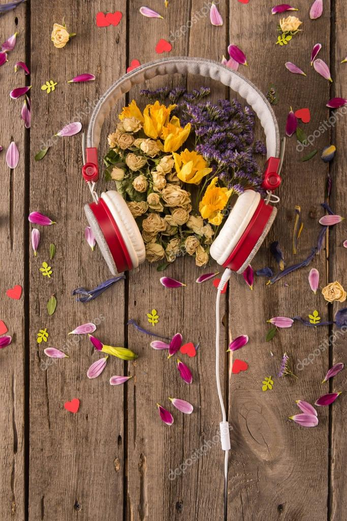 Headphones and flowers on table