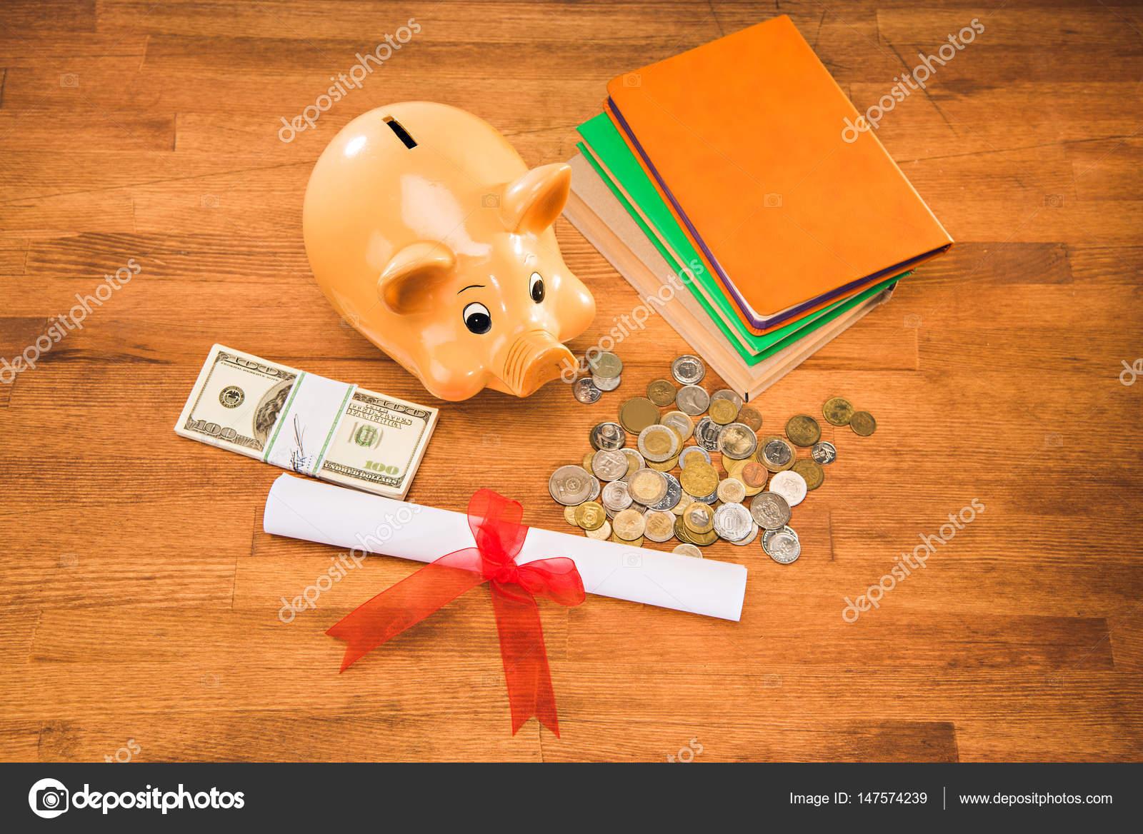 diploma and piggy bank stock photo © sergpoznanskiy  diploma and piggy bank stock photo 147574239