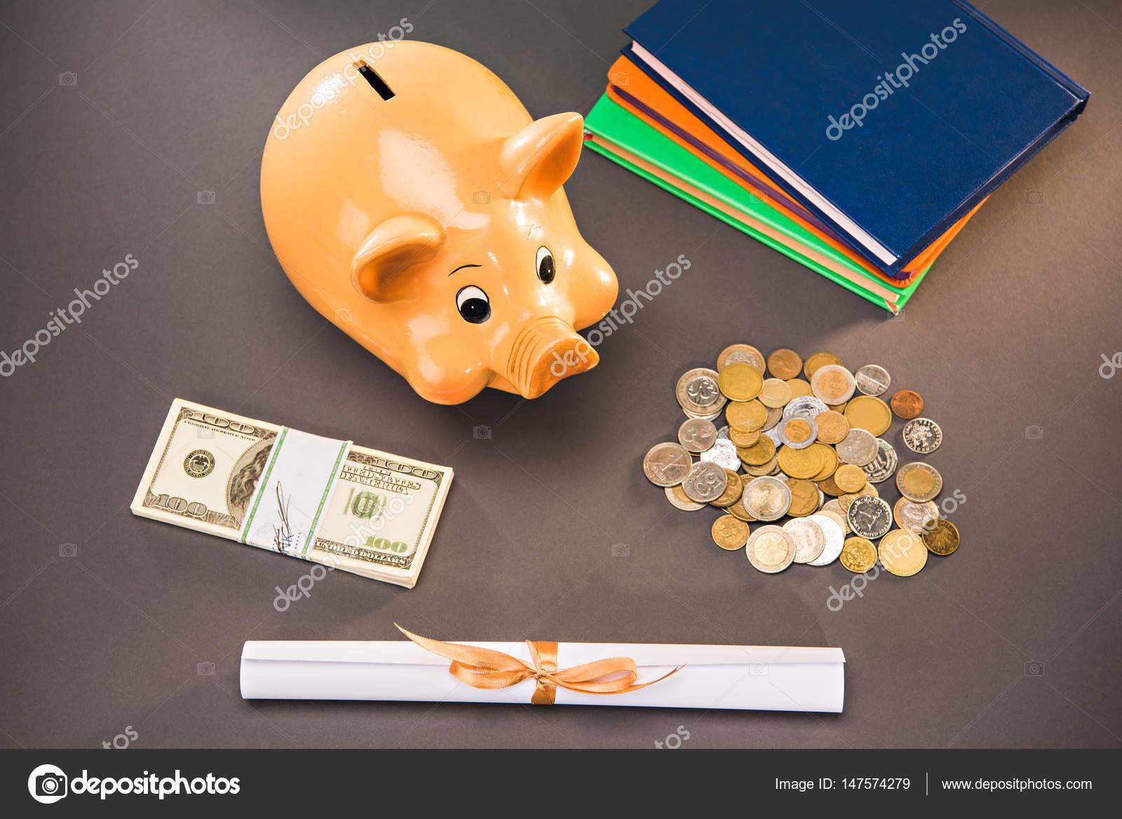 diploma and piggy bank stock photo © sergpoznanskiy  diploma and piggy bank stock photo 147574279