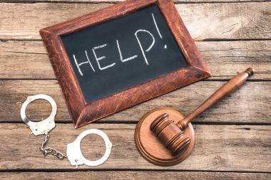 handcuff, judge hammer and chalkboard