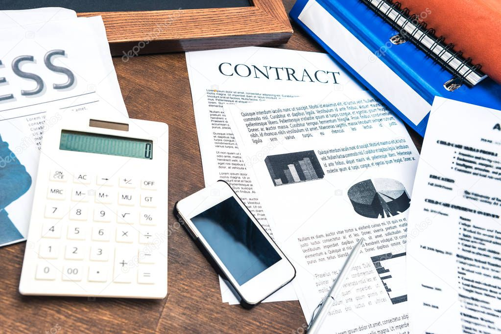 documents, smartphone and business items