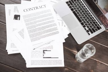 Contract documents and laptop