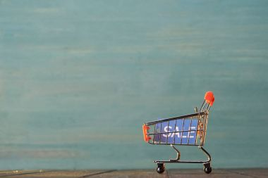 Small shopping cart with sale sign