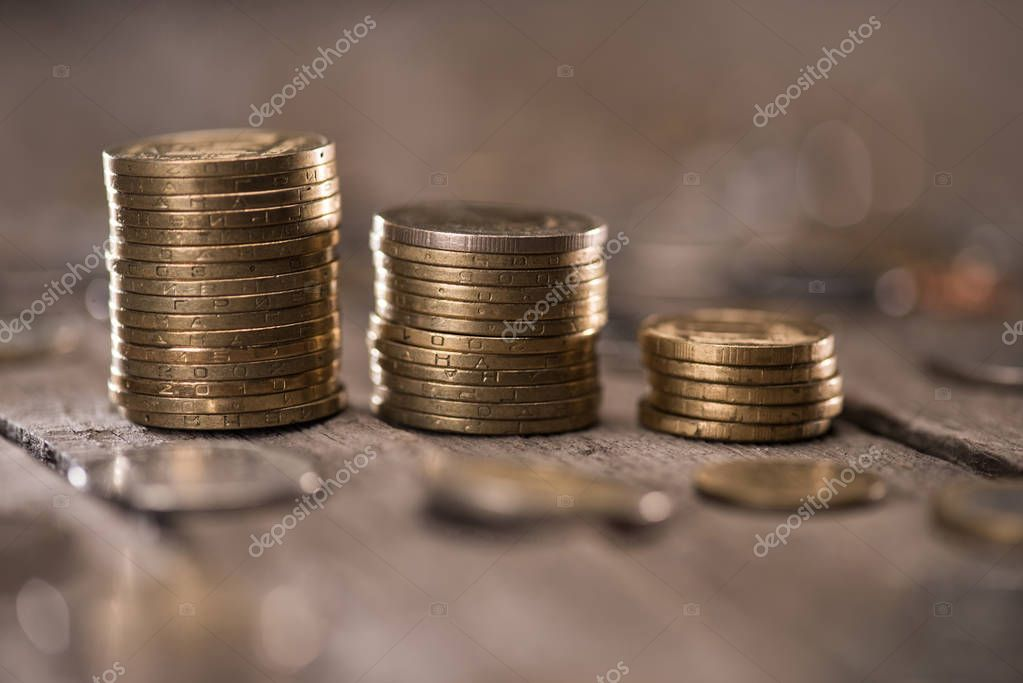 Stacks of coins on wooden tabletop