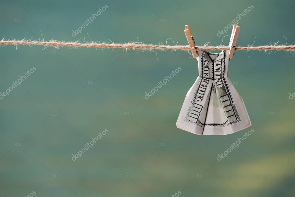 dollar banknote on clothesline