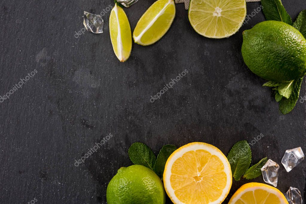 lime and orange slices with mint leaves