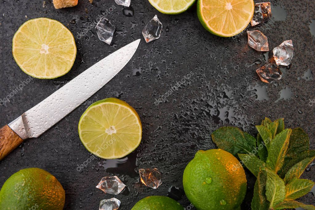 lime slices with mint leaves and knife