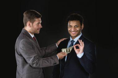 Businessman bribing partner