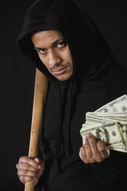 robber with baseball bat and money