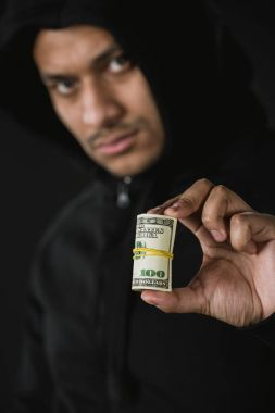 african american robber holding money