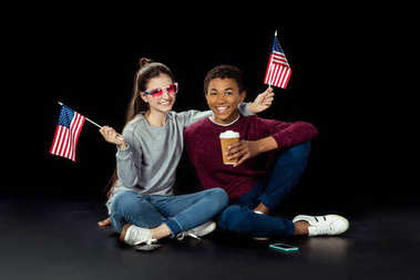 teen couple with usa flags