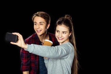 Teen couple taking selfie isolated on black stock vector