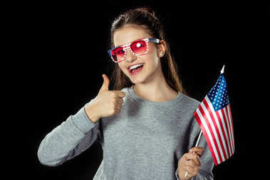 Teen girl with usa flag showing thumb up isolated on black stock vector