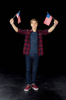 teen boy with usa flags