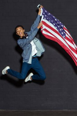 teen boy with usa flag
