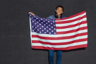 teen boy with usa flag