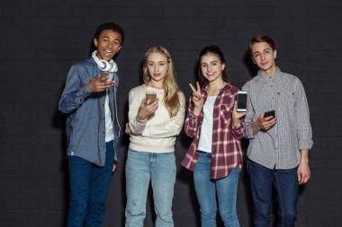stylish teenagers with smartphones