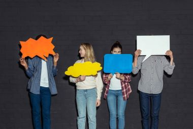 teenagers holding blank speech bubbles