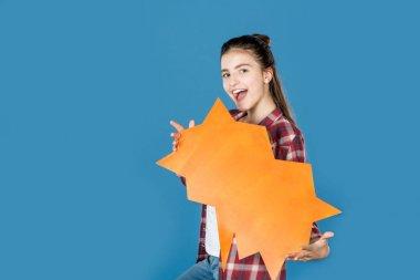 teen girl holding speech bubble