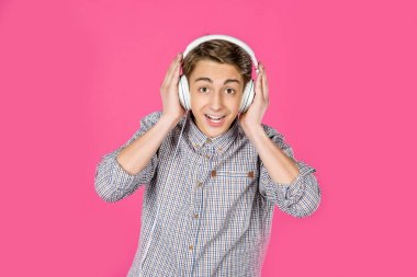 boy listening music with headphones