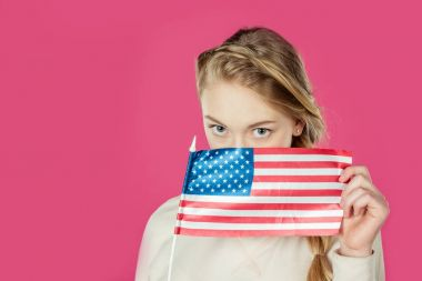 girl covering face with usa flag