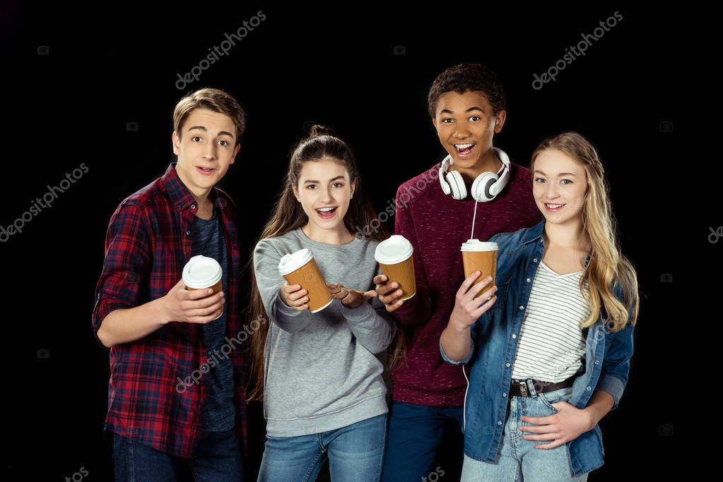 teens with cups of coffee to go