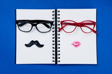 pairs of glasses on notebook