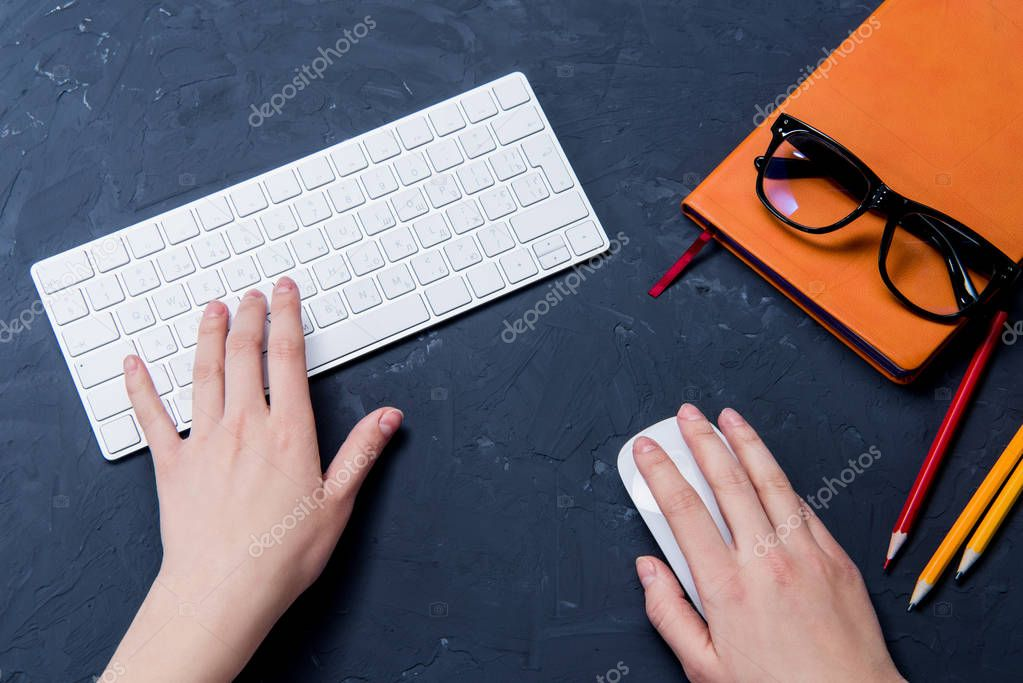 hands with office supplies