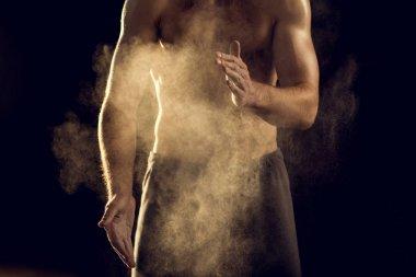 sportsman with chalk powder