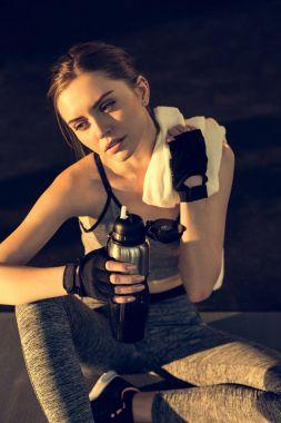 Tired sportswoman resting