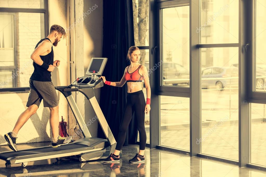 Sportspeople training with treadmill