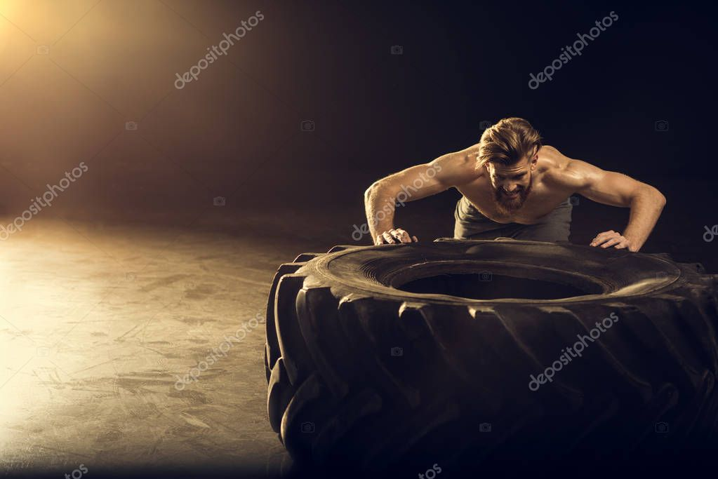 sportsman training with tire