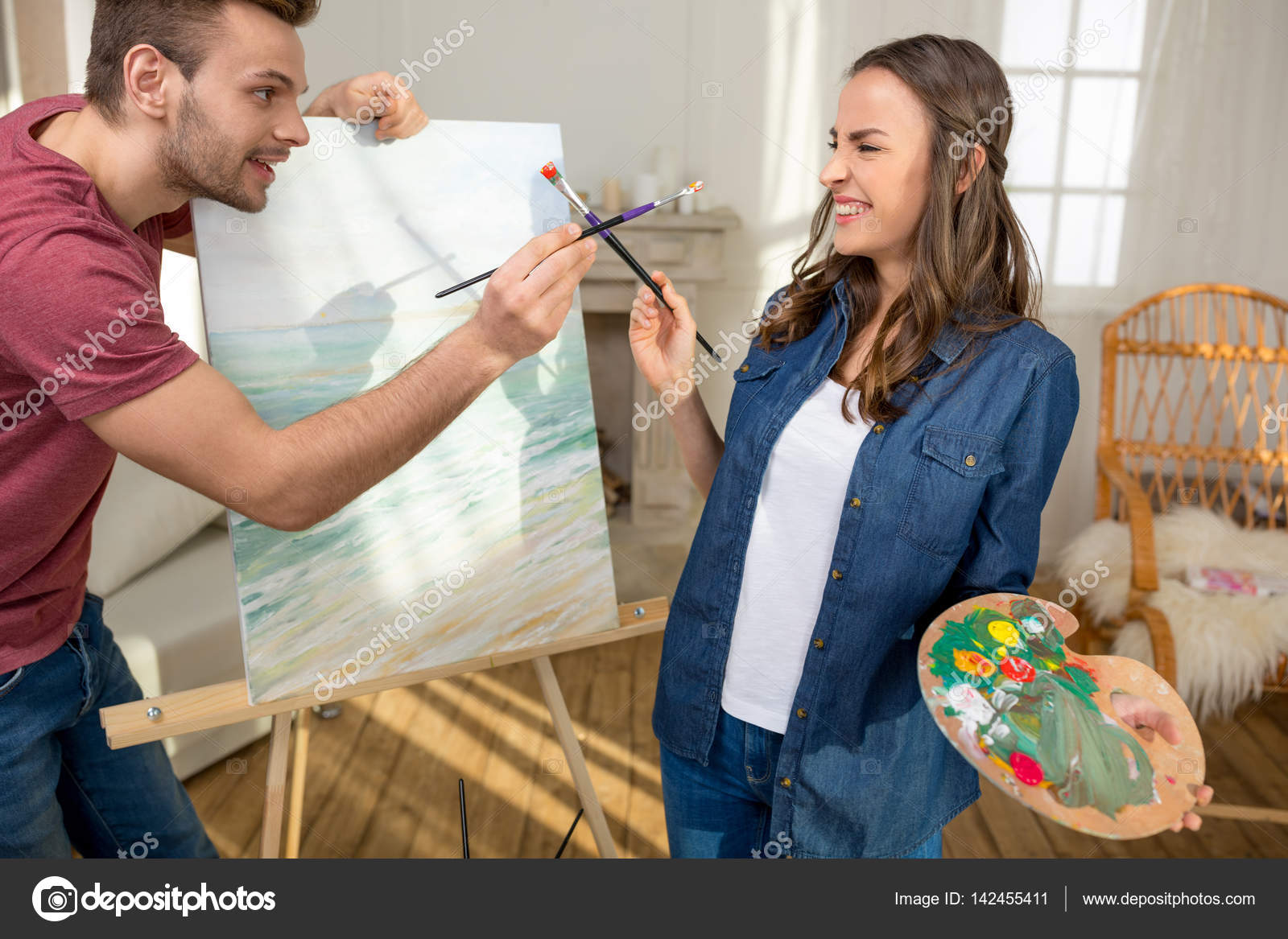 Young Couple Painting Together Stock Photo