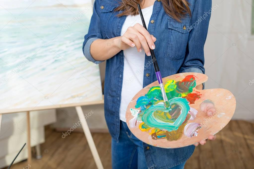 Woman artist painting picture
