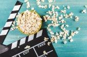Popcorn and movie clapper