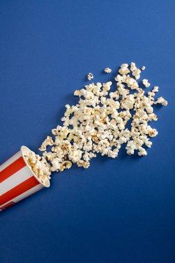 Falling popcorn in box