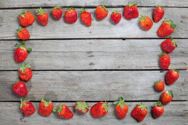 frame of fresh strawberries