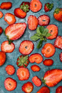 sliced strawberries background