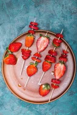 strawberries on wooden skewers
