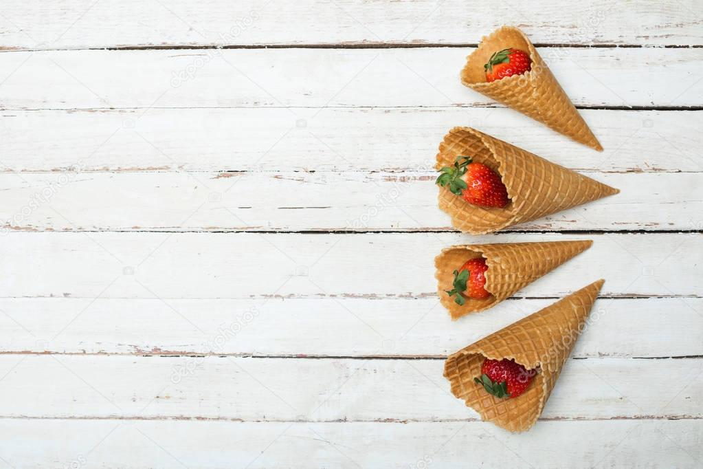 strawberries in waffle cones