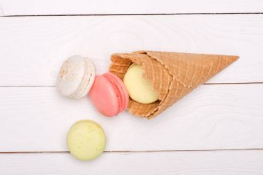 Colorful macarons in waffle cones