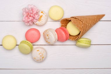 Stack of sweet macaroons and waffle cones