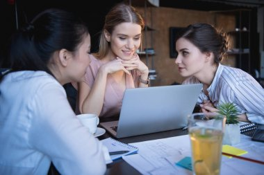 young businesswomen working on laptop at office