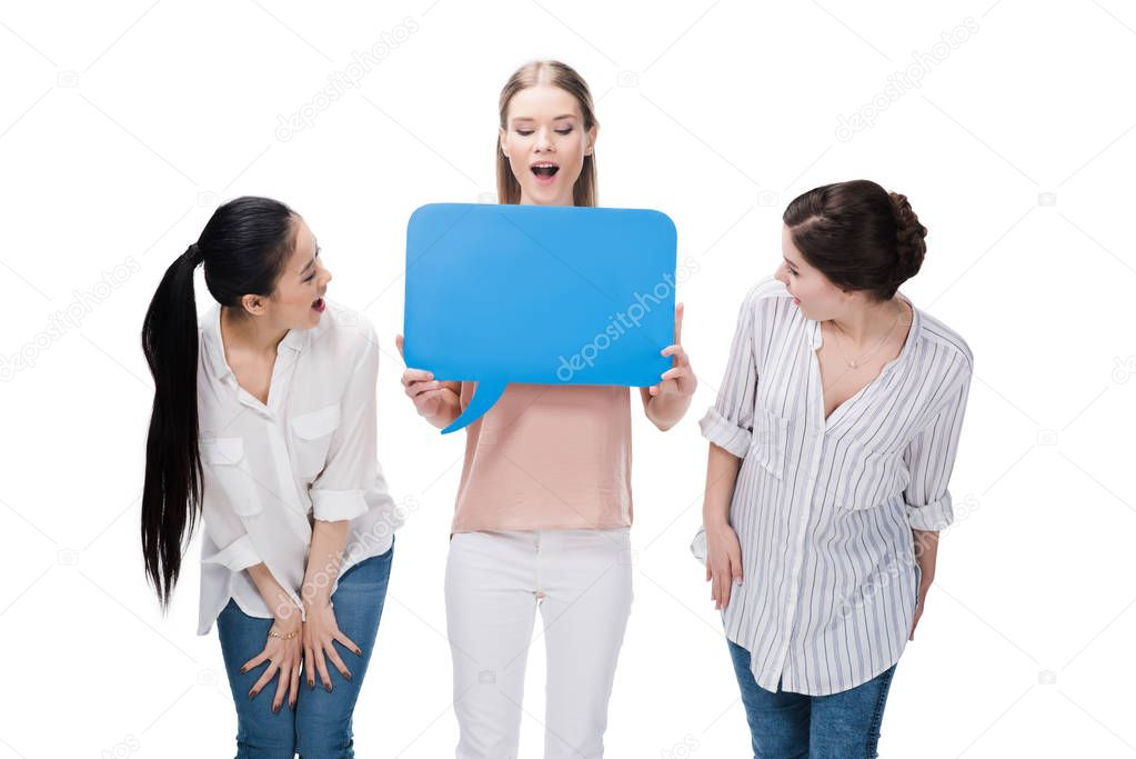 girls holding blank speech bubble