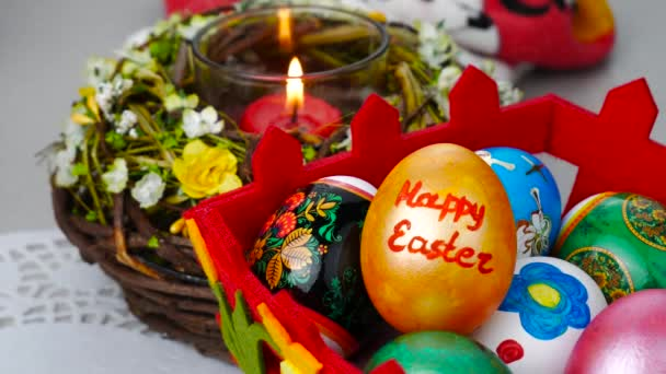 Happy easter felicitation. Colorful eggs in a bascket
