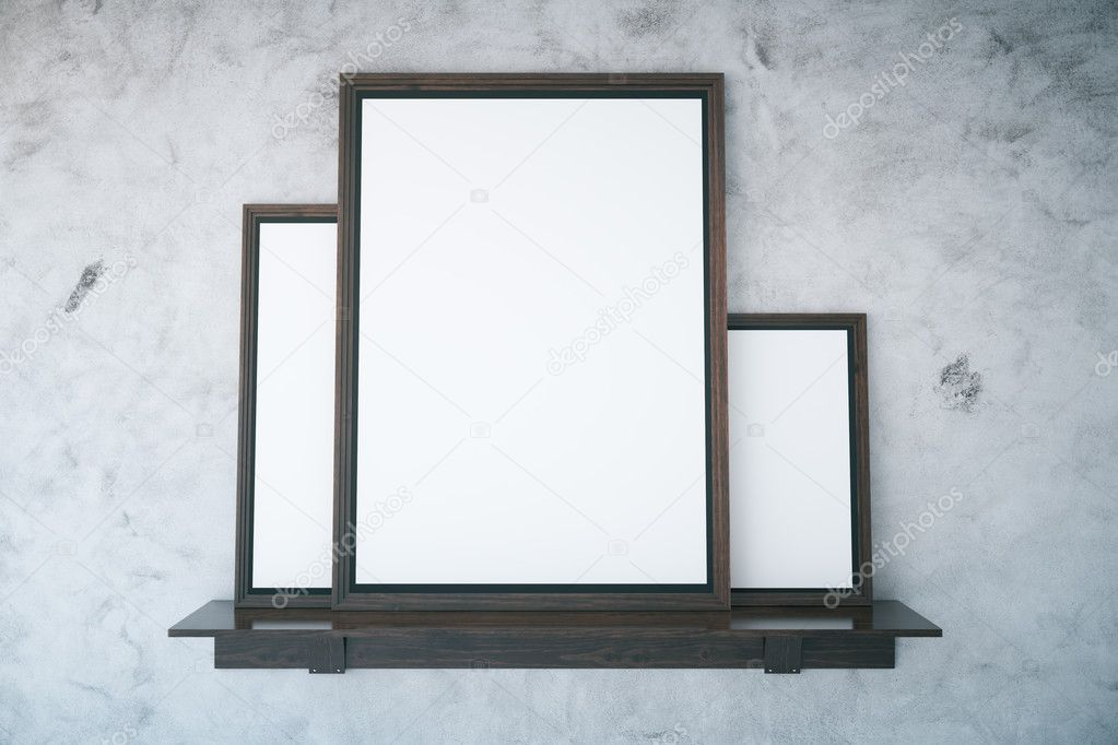 Concrete wall with empty frames — Stockfoto © peshkova #124902614